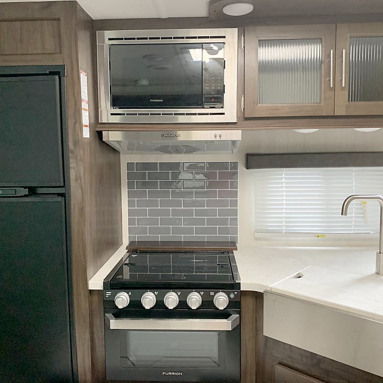 Full kitchen,four burner stovetop, microwave, oven, refrigerator, and pantry.