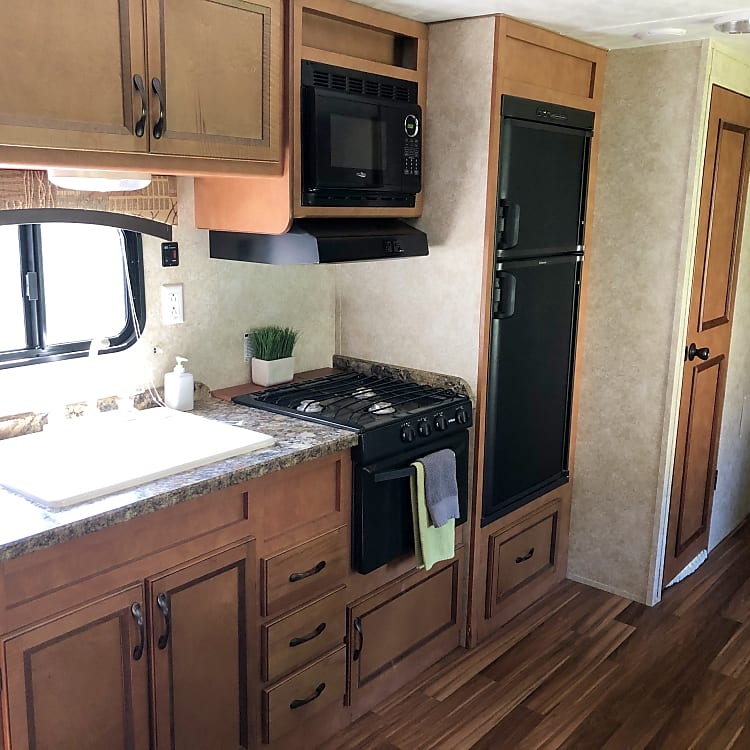 Kitchen with dual basin sink, stove, cooktop, microwave, separate fridge/Freezer, Stocked!
