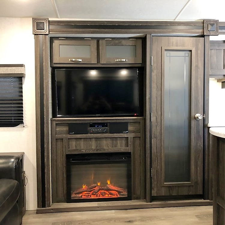 """Spacious pantry, fireplace, and 42"""" television."""