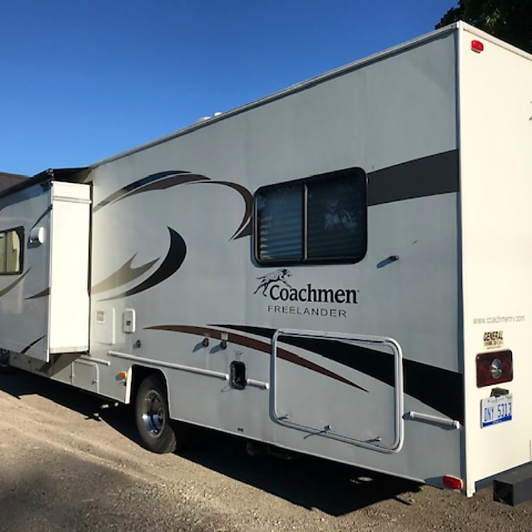 Left side of RV with Main living area slide out