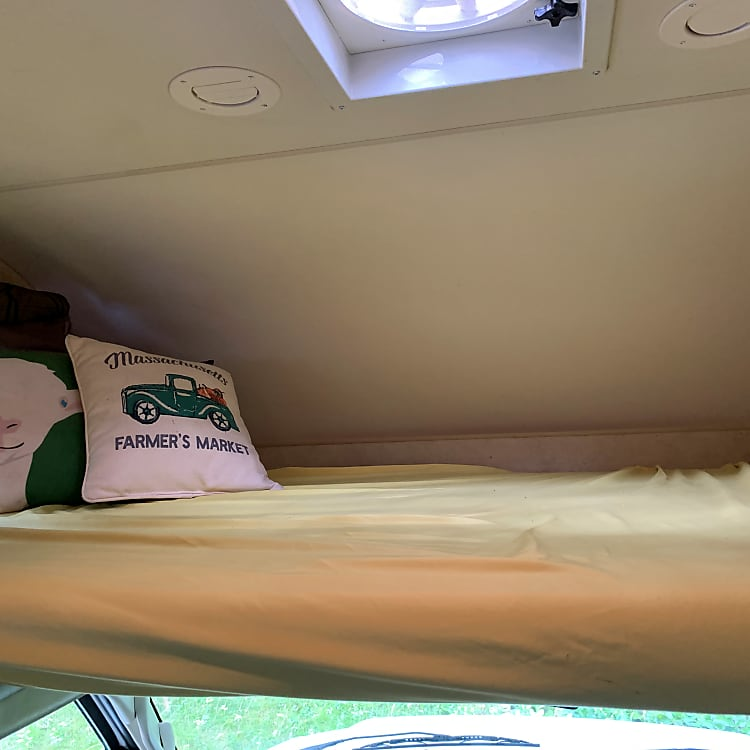 Above cab queen bed