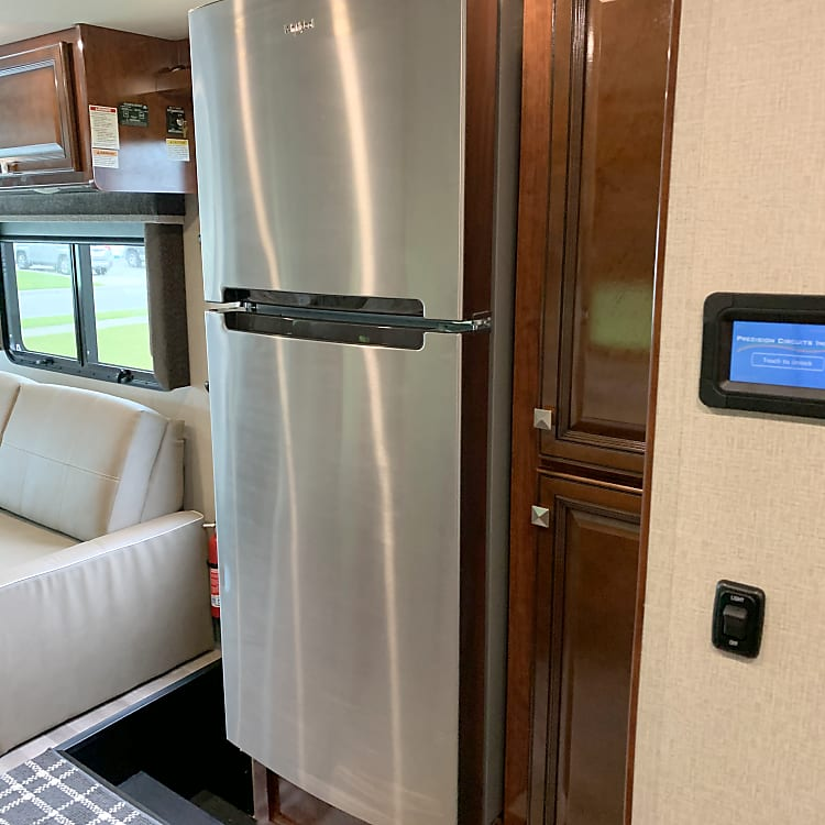 Full size stainless steel residential refrigerator and freezer.
