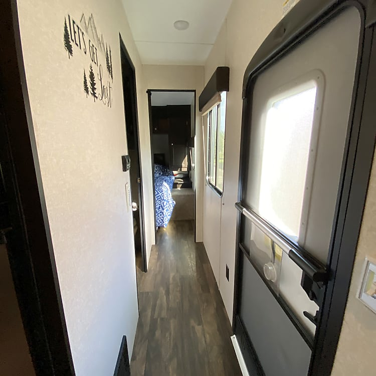 Hallway to private bedroom