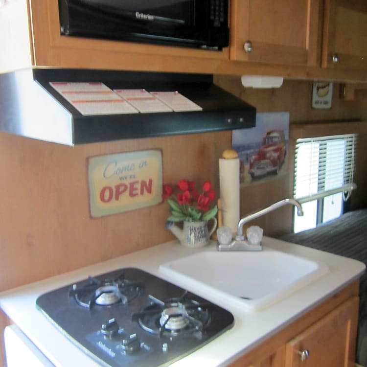 Sink, propane stove with vent hood