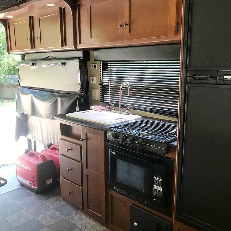 Kitchen: microwave, stove, sink