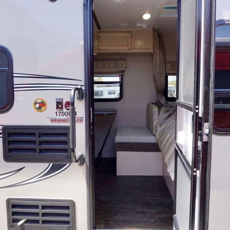 From outside looking in you will find the Full bed to the right and the dinette is straight ahead.