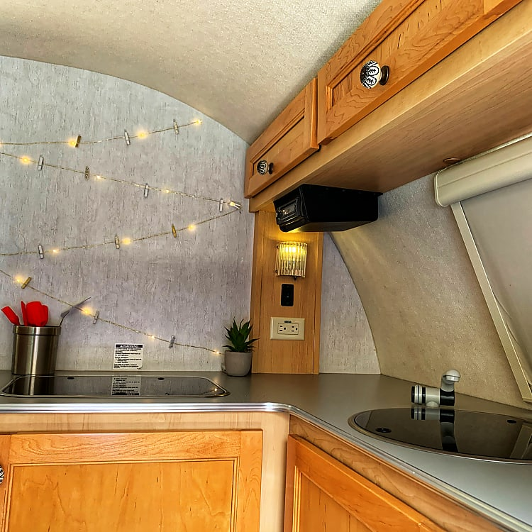 Sink and stove lid fold down to give you more counter space.