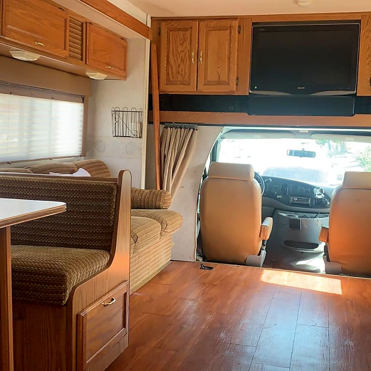 Dinette seats 4, sofa seats 3, RV has 9 total seat belts. Room for multiple car seats. Flat screen TV for road trip entertaiment.