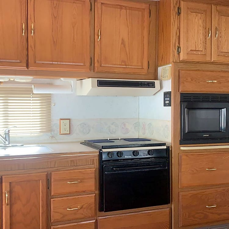 Microwave, fridge, freezer (works great!), sink, stove, oven, all dishes + utensils included.