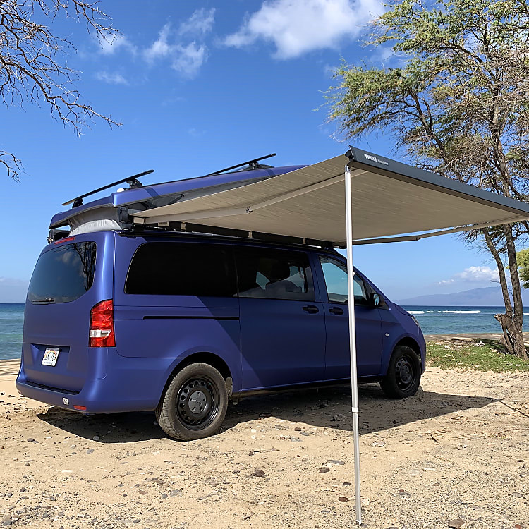 Rear Quarter View with Awning and Top Popped