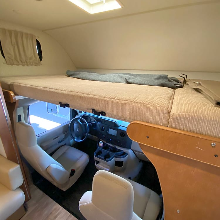 Bed (and stowed ladder + privacy curtain) above the cab.