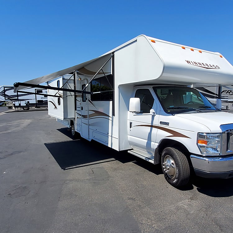 Electric awning which only takes seconds to set up and enjoy the shade. (2) electric slide outs turns your RV into a spacious home.