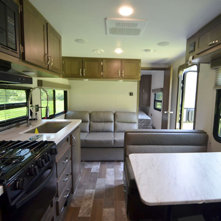 Lot of seating and a comfy dining table