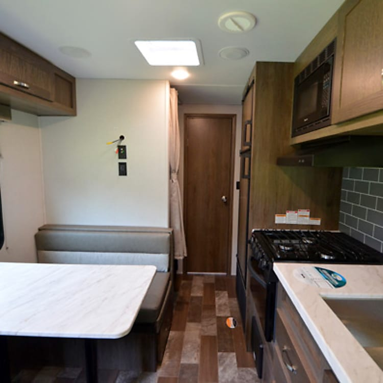 Full kitchen includes gas stove, oven, microwave, deep sink and plenty of storage space