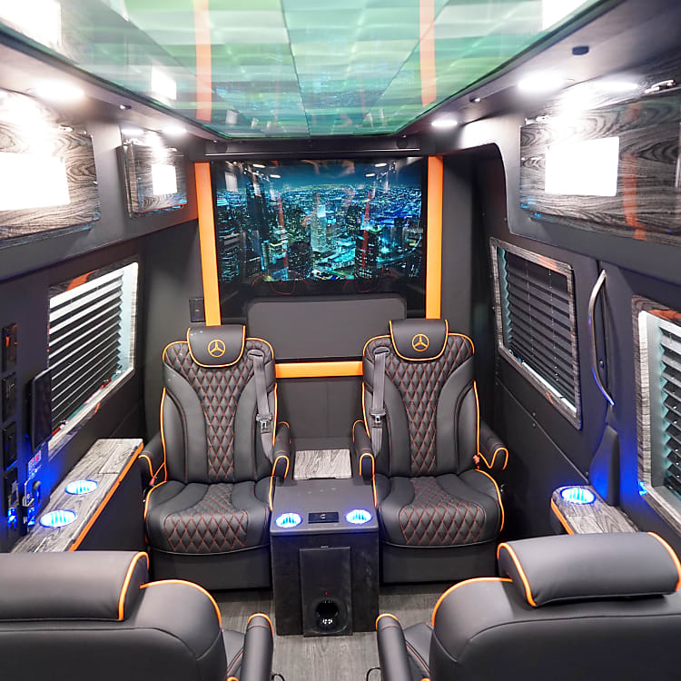 Seats for 8, overhead storage, 3 coolers, lots of accent lighting