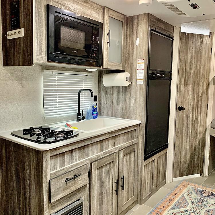 Modern kitchen, sink, refrigerator,2 burner stove, microwave
