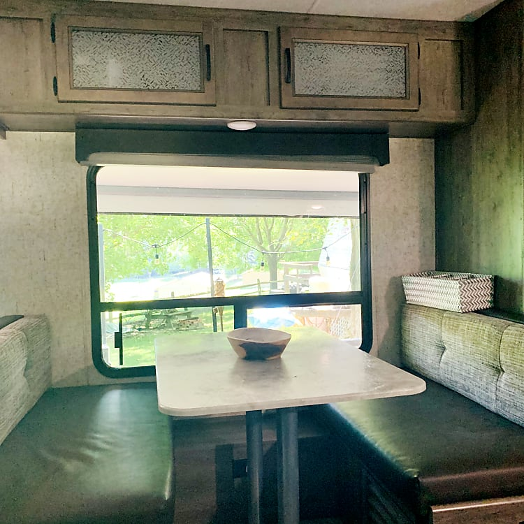 4-person dinette (converts to bed) w/ large window overlooking campsite