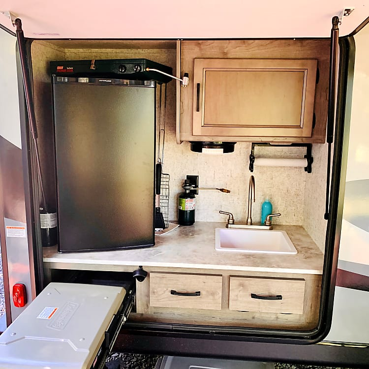 Outside Kitchen with fridge, sink, & pull-out grill
