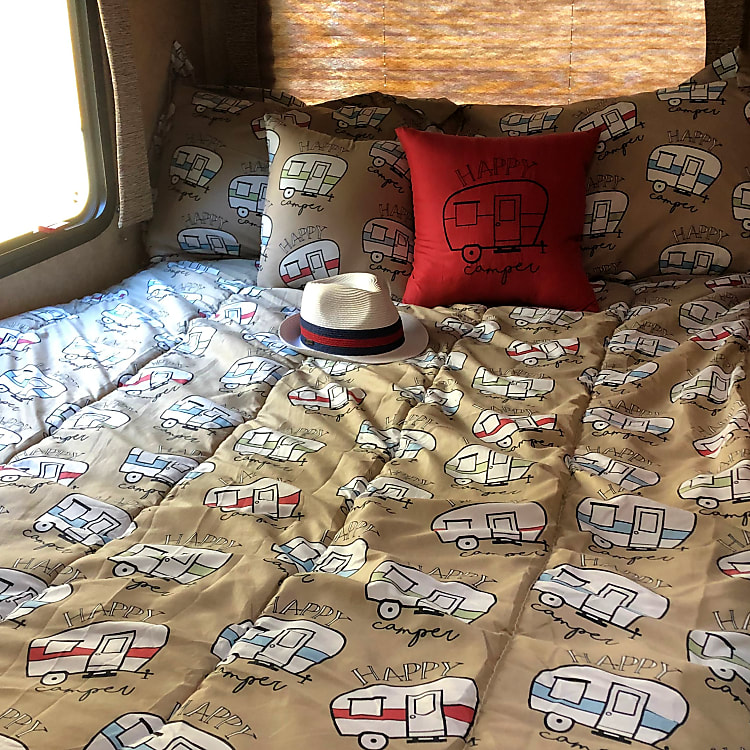comfy bed with all the bedding you need for your glamping trip