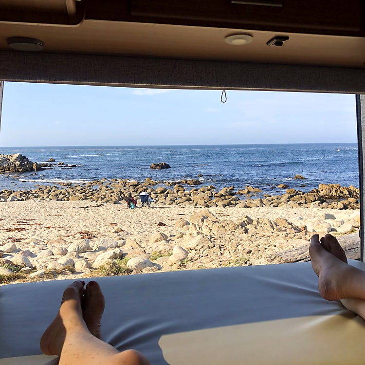 Enjoy a gorgeous view while relaxing on a comfy king bed, sipping your favorite beverage!