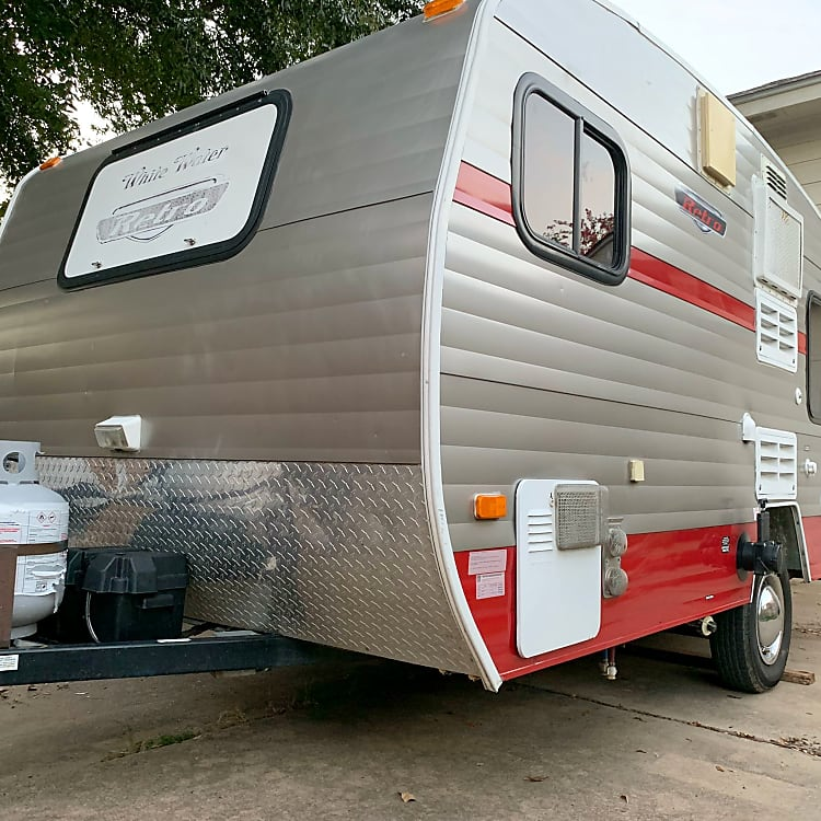 NOT your grampa's canned ham—this tiny 13 ft. long camper LOOKS retro—but inside, it's outfitted with top-of-the-line amenities and comfort.