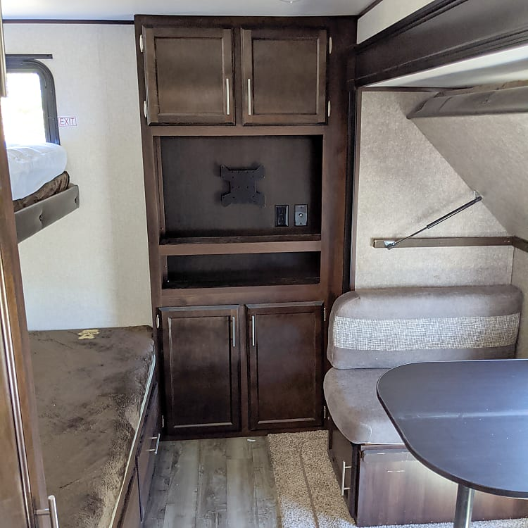 Second bedroom with 4 bunks and a foldup dining table.