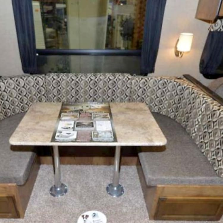 U shaped dining table (makes into a bed)