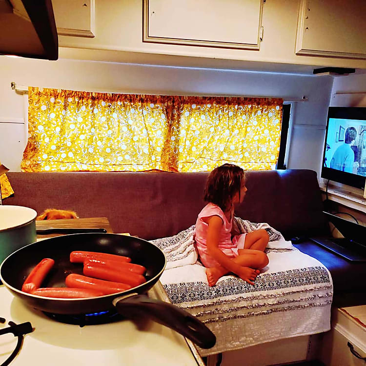 3 burner stove and fridge storage for delicious meals and even popcorn over the stove for movie night!