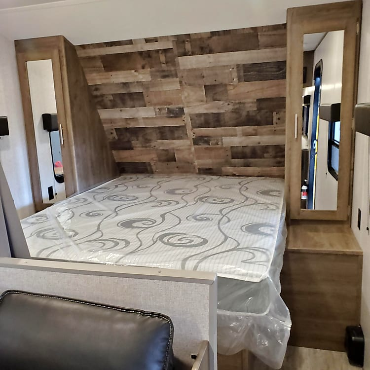 Queen size bed with individual closets