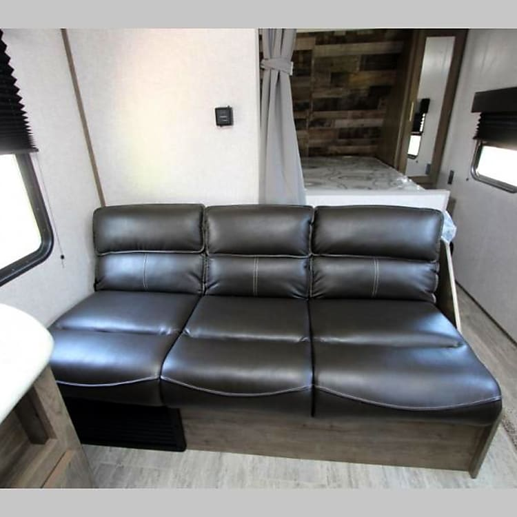 Large sofa with pull down cup holders