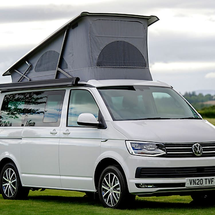 Our VW California Ocean has a pop up roof housing a second double bed