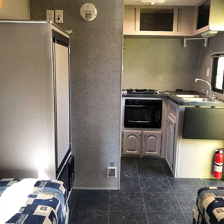 Kitchen with microwave, sink, and range.
