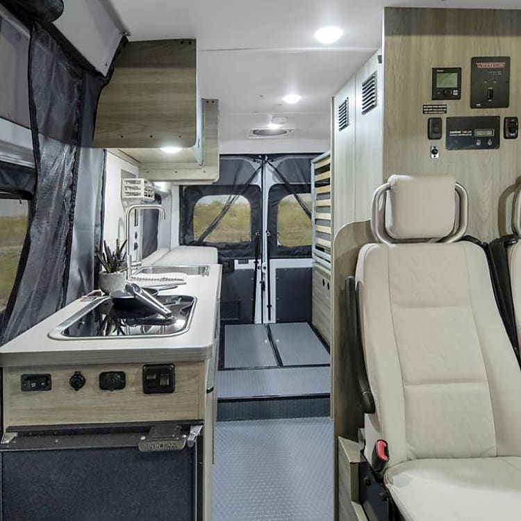 View of passenger seats, kitchen and out the back
