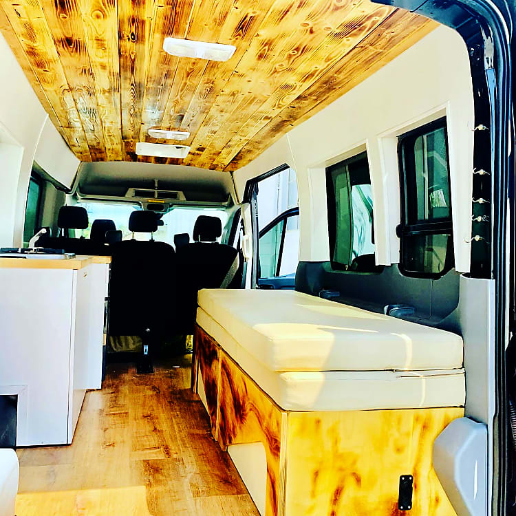 Wood Pine Ceiling & Wall Paneling with cup holders, chargers etc. Includes a full kitchen with fridge, sink, stove, utensils, pans etc