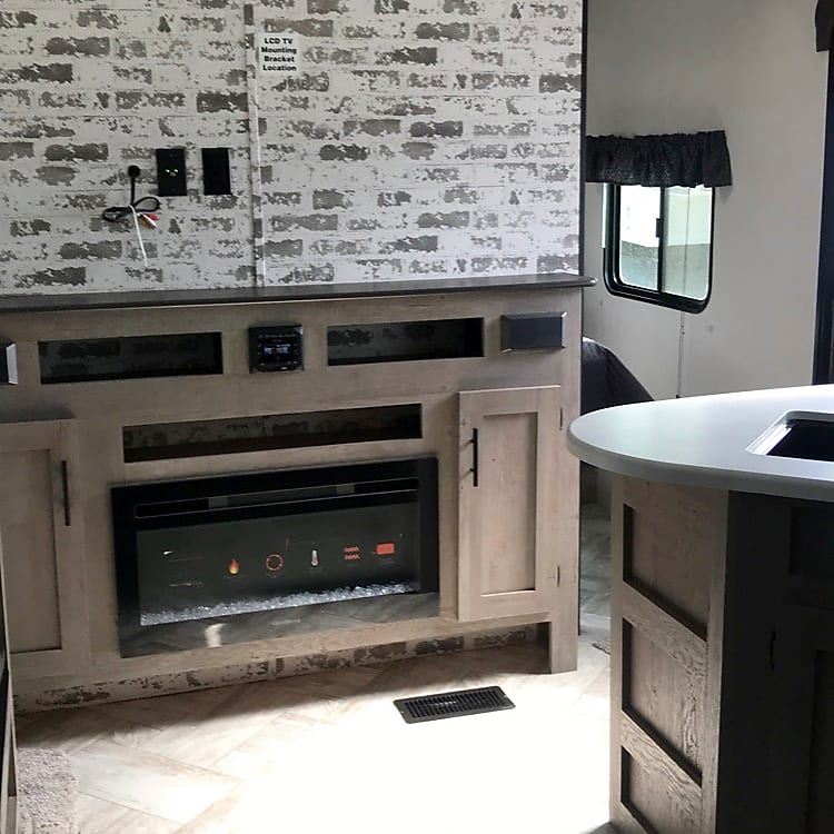 Fireplace and entertainment center with cd player, radio, usb and bluetooth connections