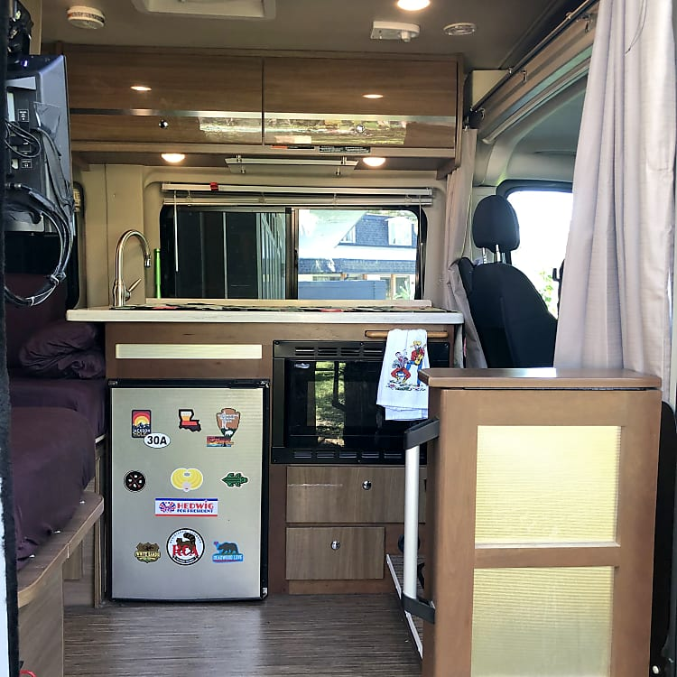 Galley includes Fridge, sink, convection microwave.