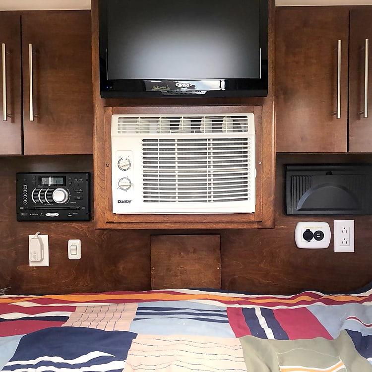 A/C. TV (with Roku), AC and DC plug ins, Bluetooth AM/FM DVD player.
