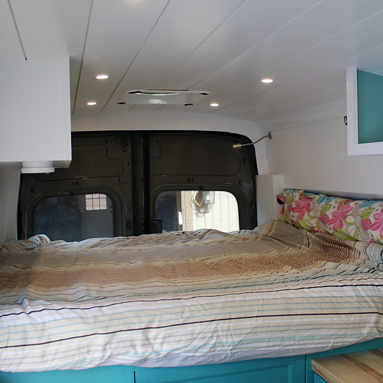 Queen size bed sideways in the back