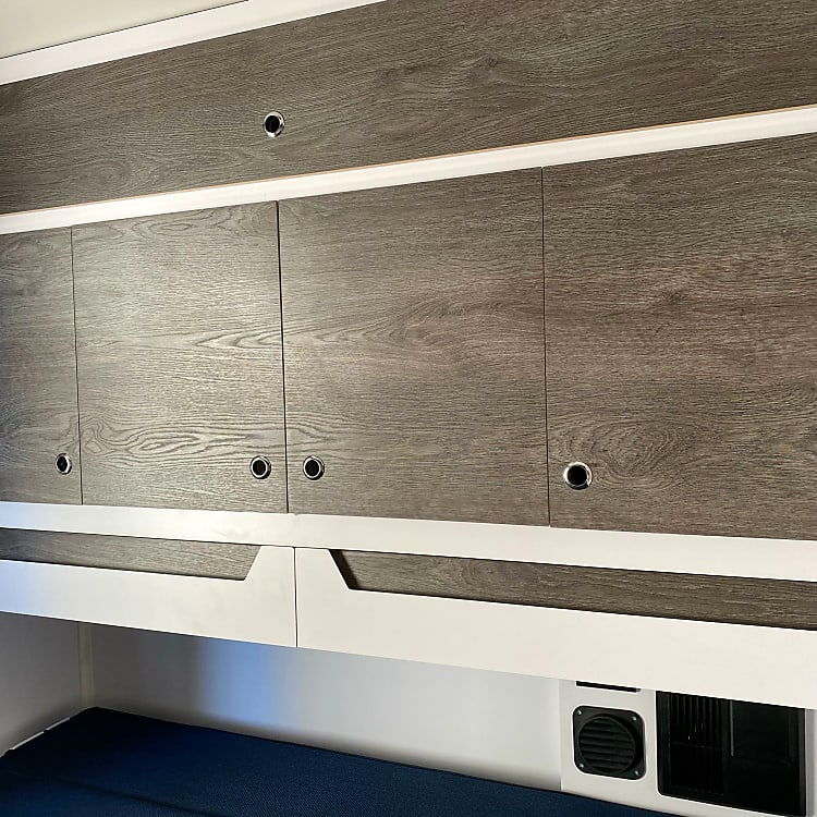 The bean has drawers and cabinets. The cabinets open on both sides for easy access.