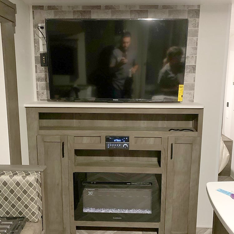 """50"""" tv and electric fireplace. DVD w/surround sound"""