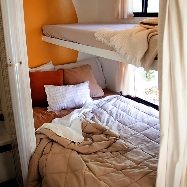 Full bed and bunk above