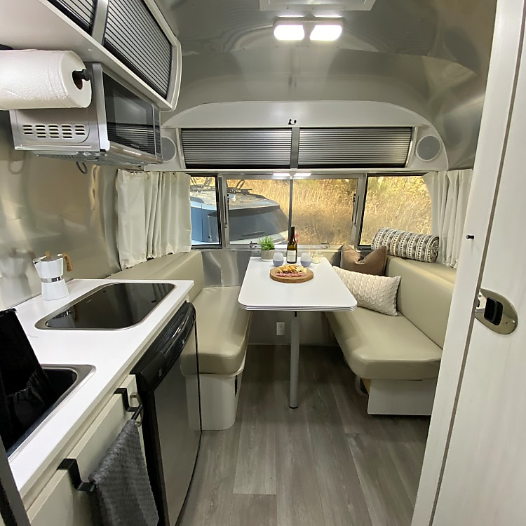 Lots of room to spread out, play a game, share a meal or turn this dining space into a bed for a 3rd person.