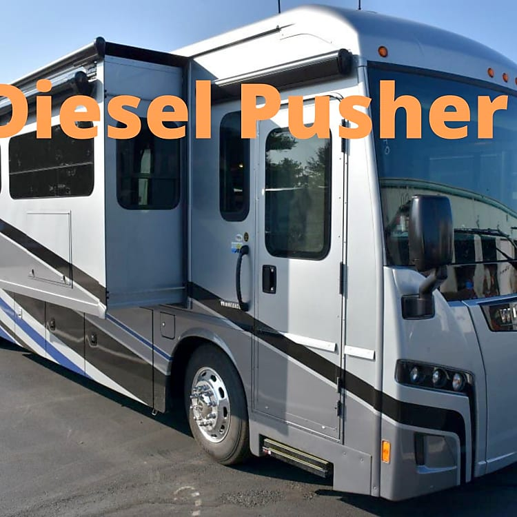 Rear Diesel Pusher with engine in the  back. Very quiet up front while driving. Air Ride Suspension. Smooth and Quiet.