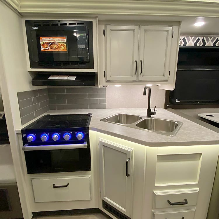 Sink, oven, convection microwave and storage