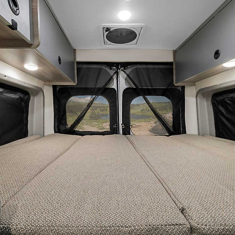 """Queen sized bed at the back of the van. I am 6'3"""" and can stretch out. The mattress is amazingly comfortable"""