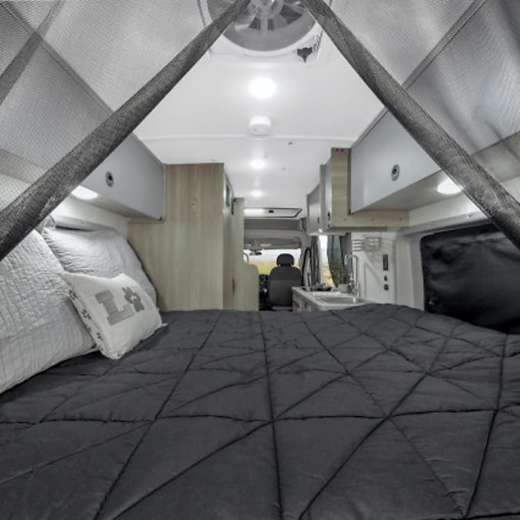 View of the aft bedroom, taken from the rear. The netting zips up to keep bugs out when you sleep with the doors open to catch the fresh air
