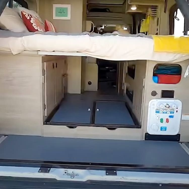 Under the aft bed is a large storage area. The panel on the lower left is the dummy proof control system for the water and plumbing.