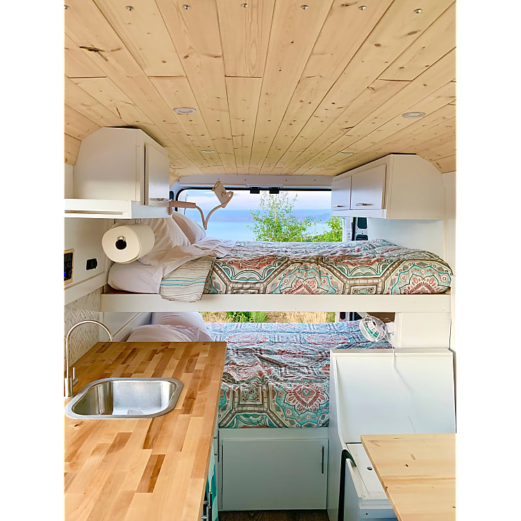 Two full-sized bunks with plenty of storage and a great view of your destination.