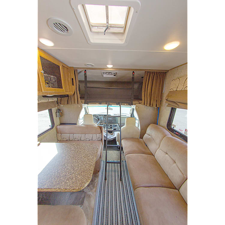 dinette, sofa and cab bunk