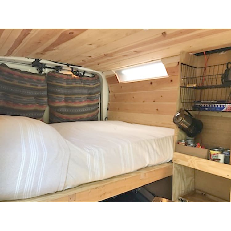 Furnished in wood paneling with cork floors, LED lighting, accent lights, ceiling fan and secure storage compartments for travel.
